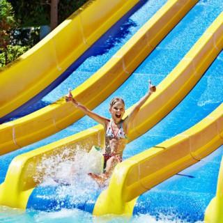 bigstock-Children-on-water-slide-at-aqu-45690550