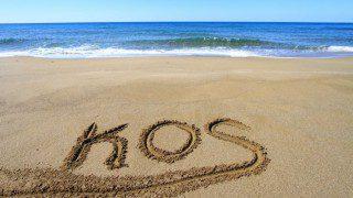 bigstock-Kos-written-on-sandy-beach-44205358