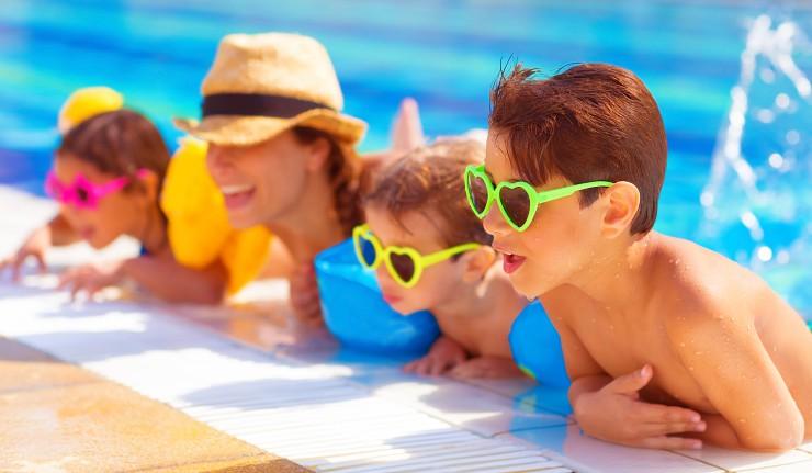 bigstock-Happy-family-in-the-pool-havi-50515637