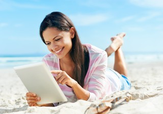 bigstock-carefree-woman-uses-touchpad-t-45051685